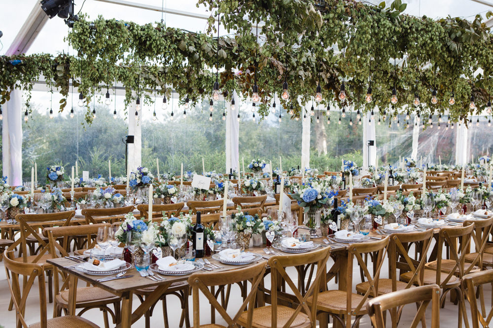 Botanical Marquee Reception with Hanging Greenery & Edison Light Installations by Lucy Davenport Photography